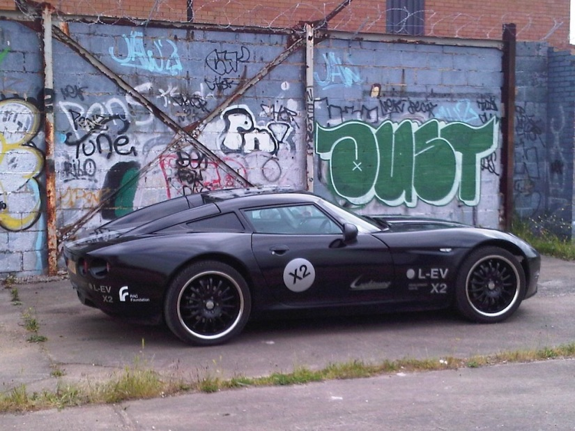 The Lightning GT Supercar against some Graffiti.jpg